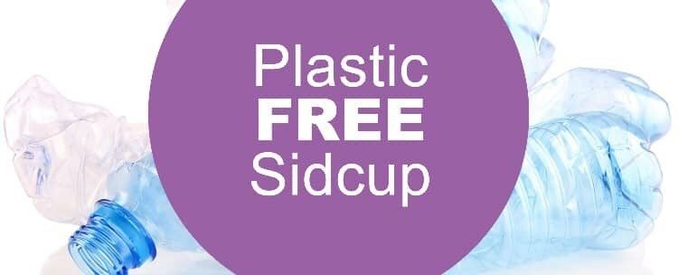 Plastic free Sidcup purple banner with plastic bottles in the background.