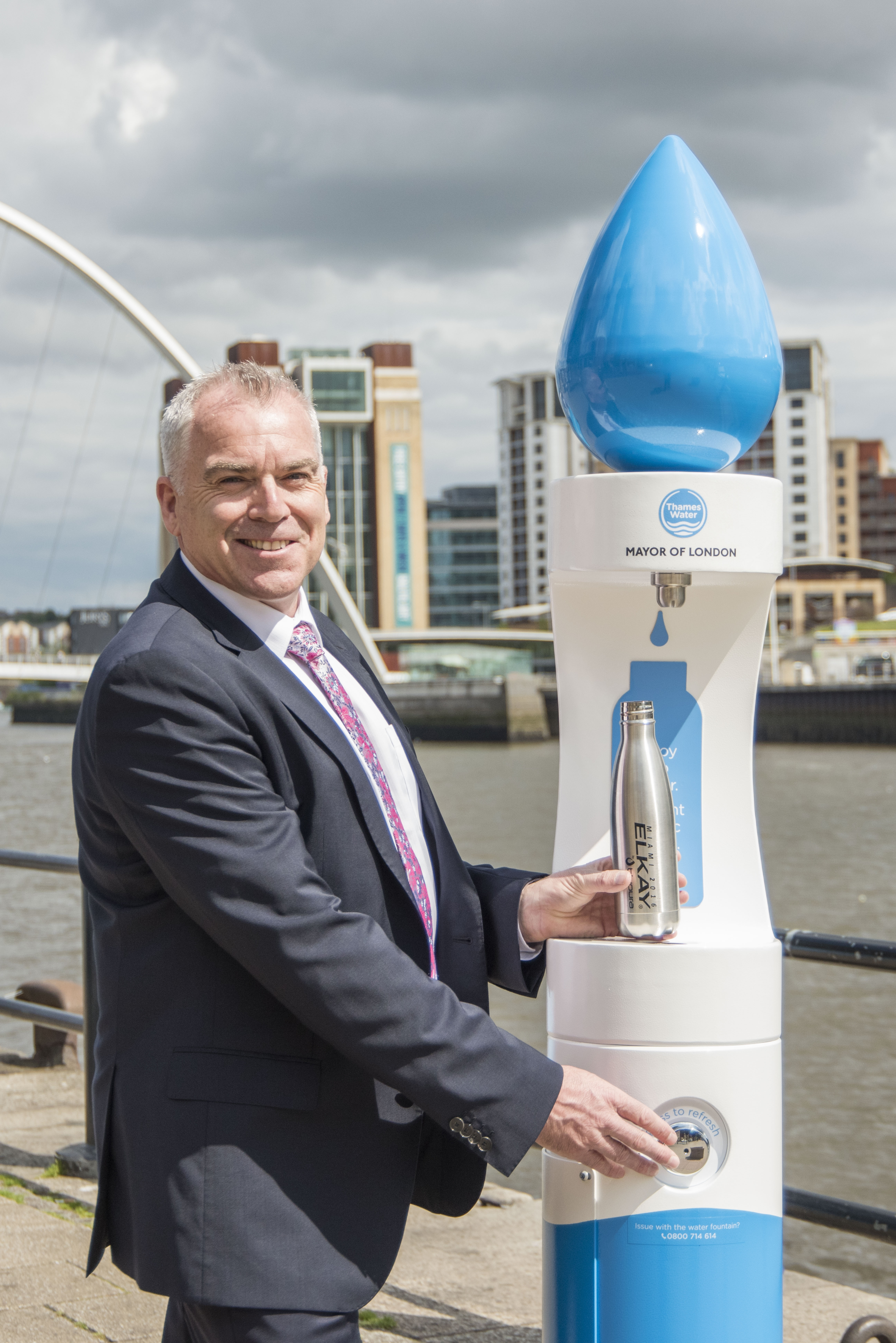 Mike Winter, the managing director at MIW, posing with the new Thames Water bottle filler on the Quayside in Newcastle.