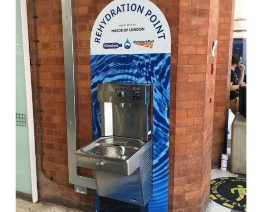 Water bottle refill station in a train station