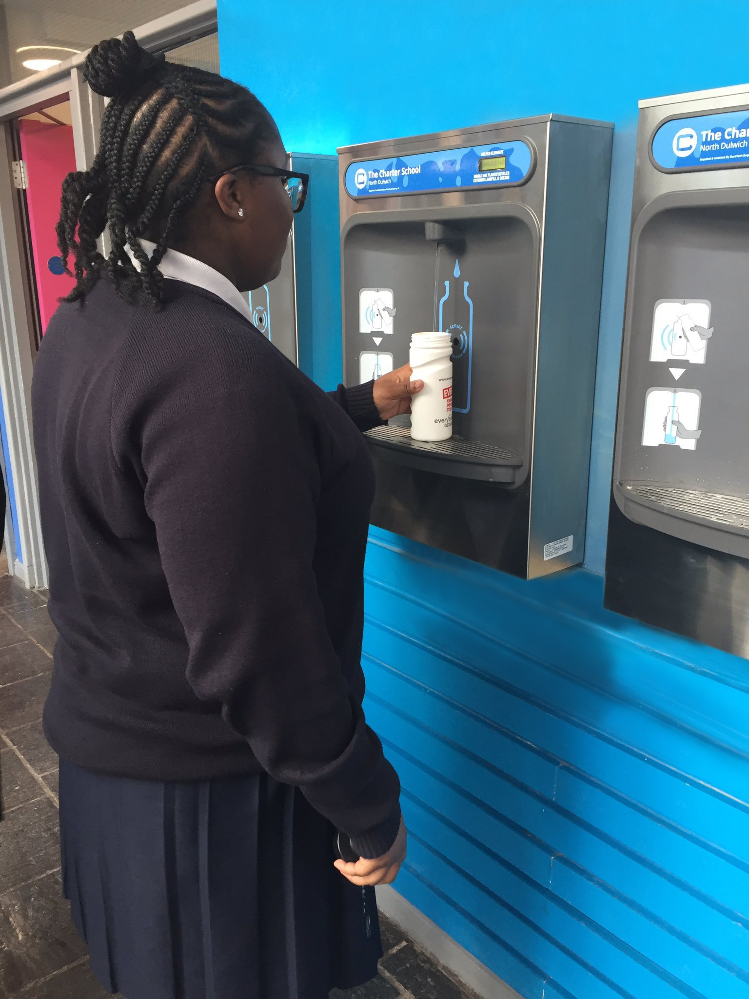 A Student Using Bottle Refill Station At The Charter School North Dulwich