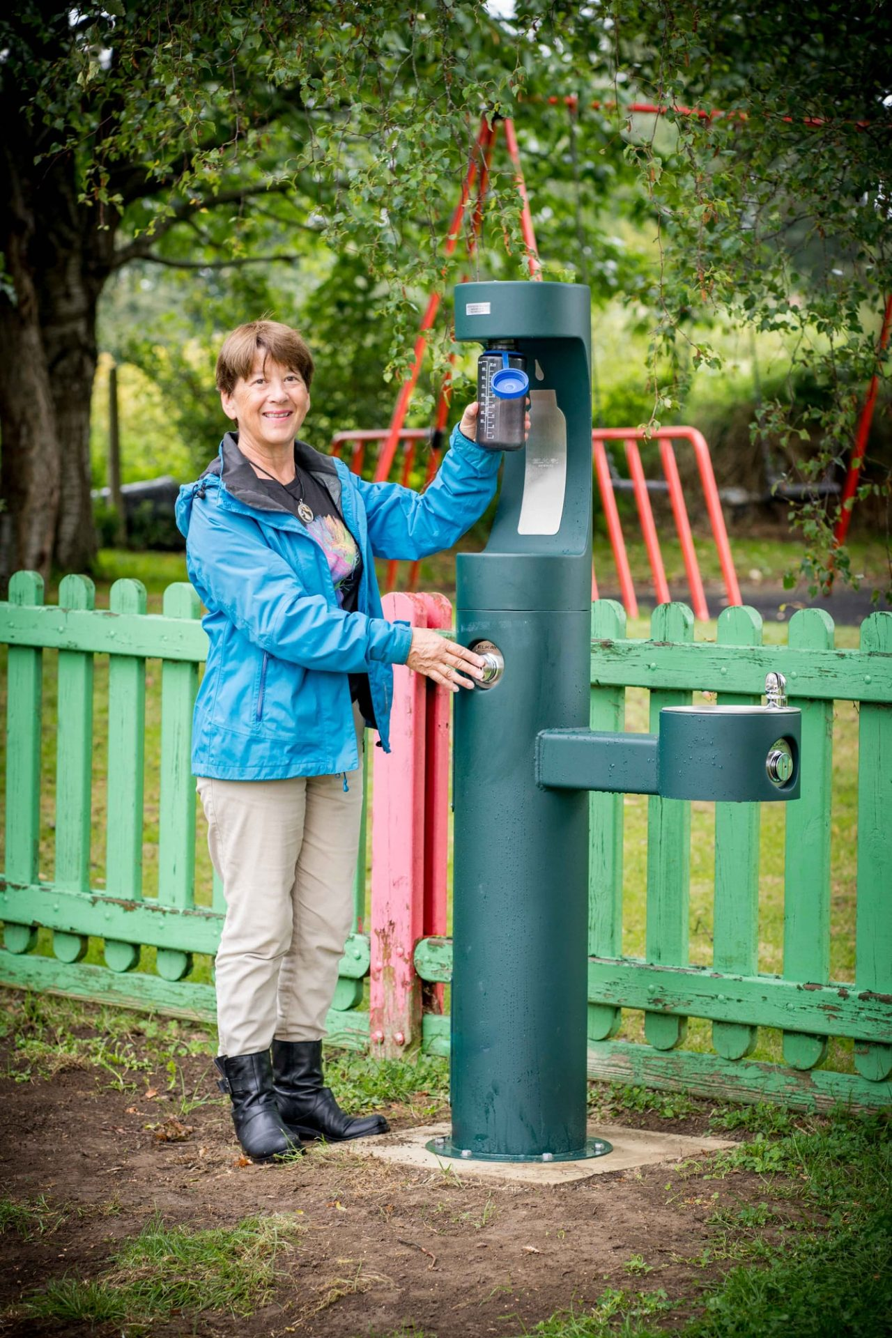 Cllr Alex Kay with the new green bottle refill station at Culver Close Recreation Ground.