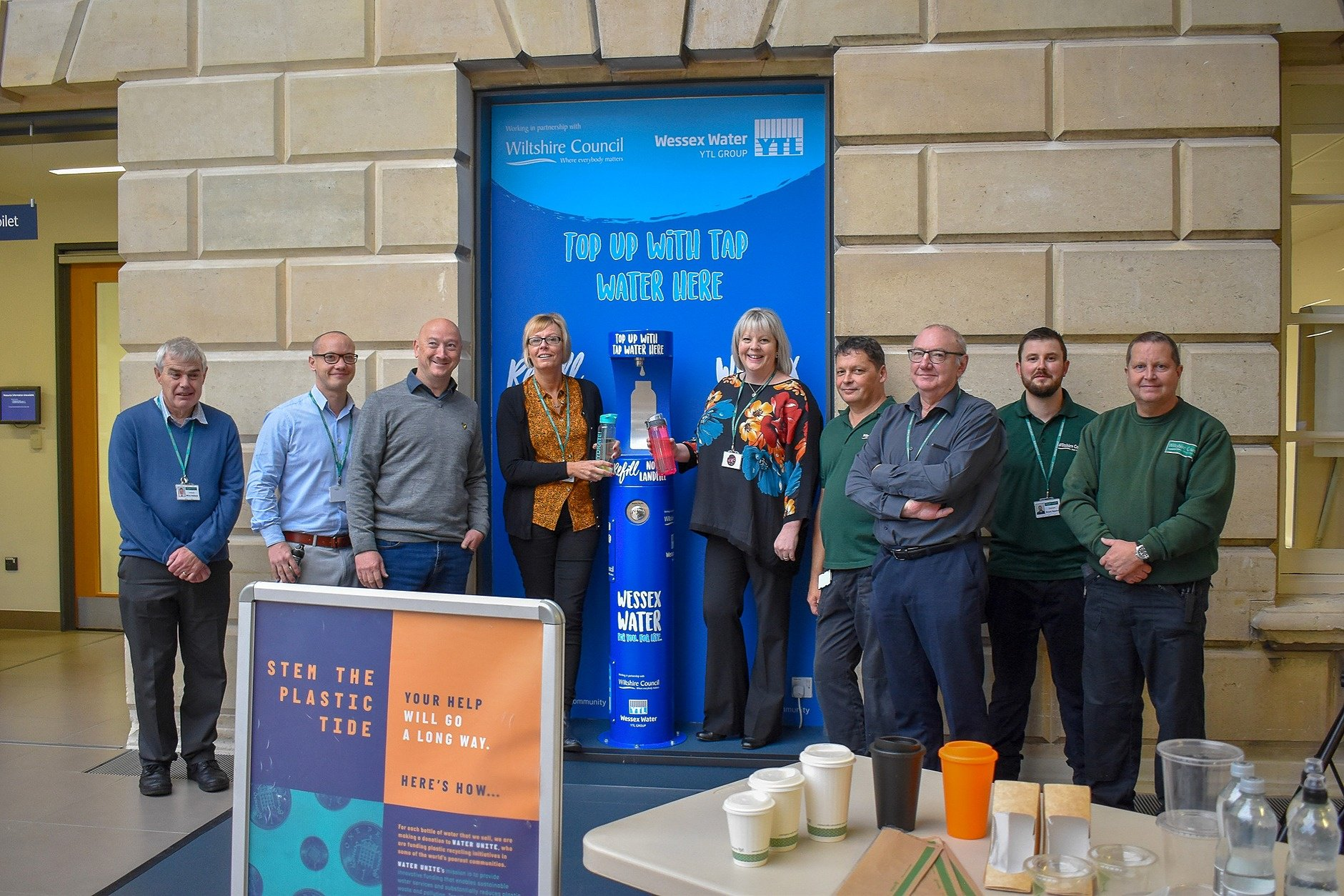 Happy people posing with the new Wessex Water bottle filler