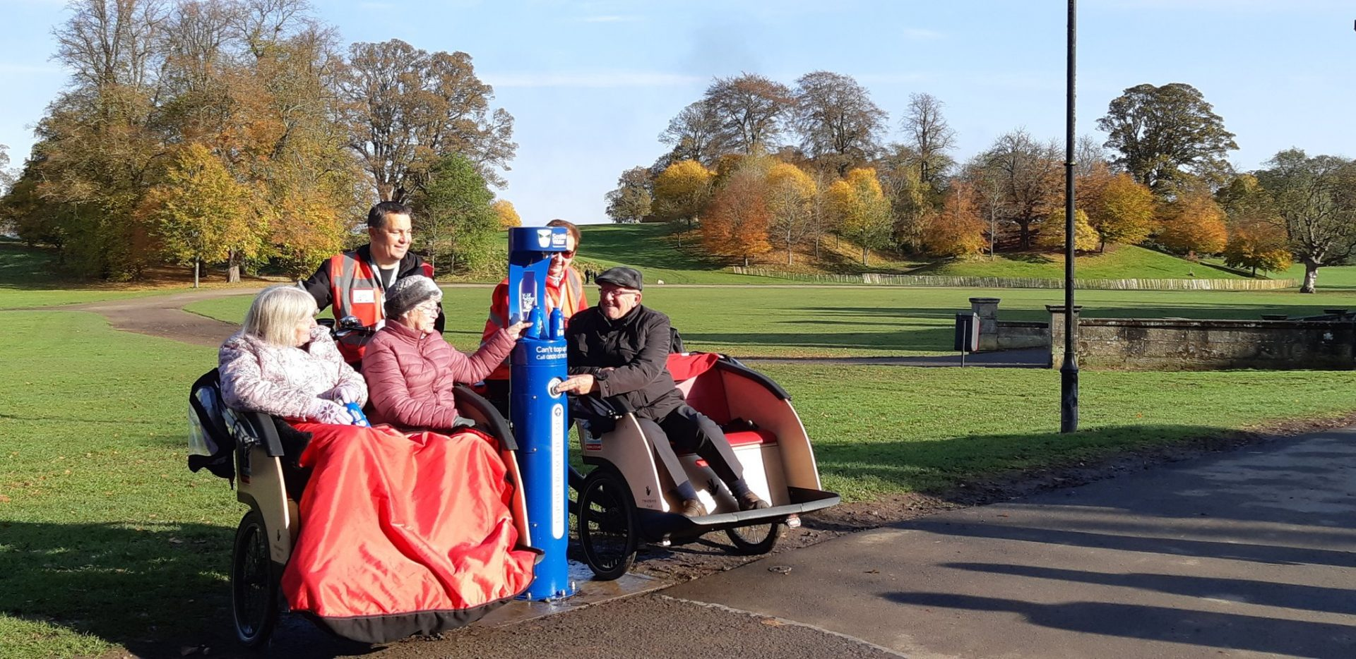 Senior residents and regulars at Falkirk Park ready to refill at the new drinking fountain.