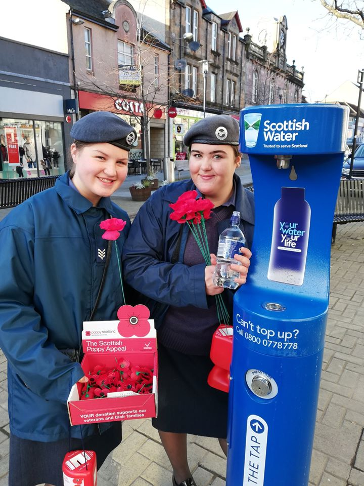 Women posing next to the new Scottish Water drinking fountain