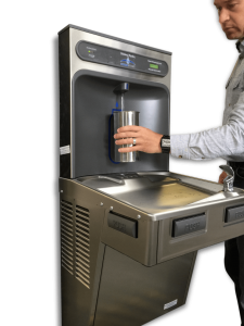 A image of a person using a contactless water bottle refill station