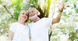 Older couple outdoors who appear to be happy
